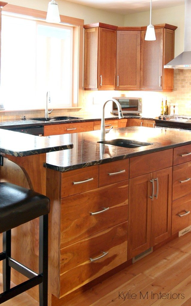 Natural fir flooring, cherry cabinets, black granite on island with prep sink