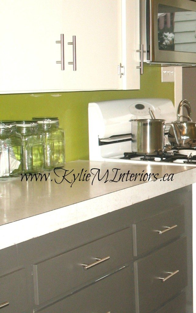 white and amherst gray 2 tone cabinets and funky green coloured walls