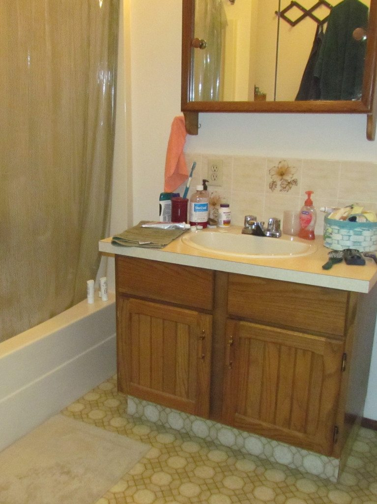 1980's bathroom with oak vanity before update and remodel