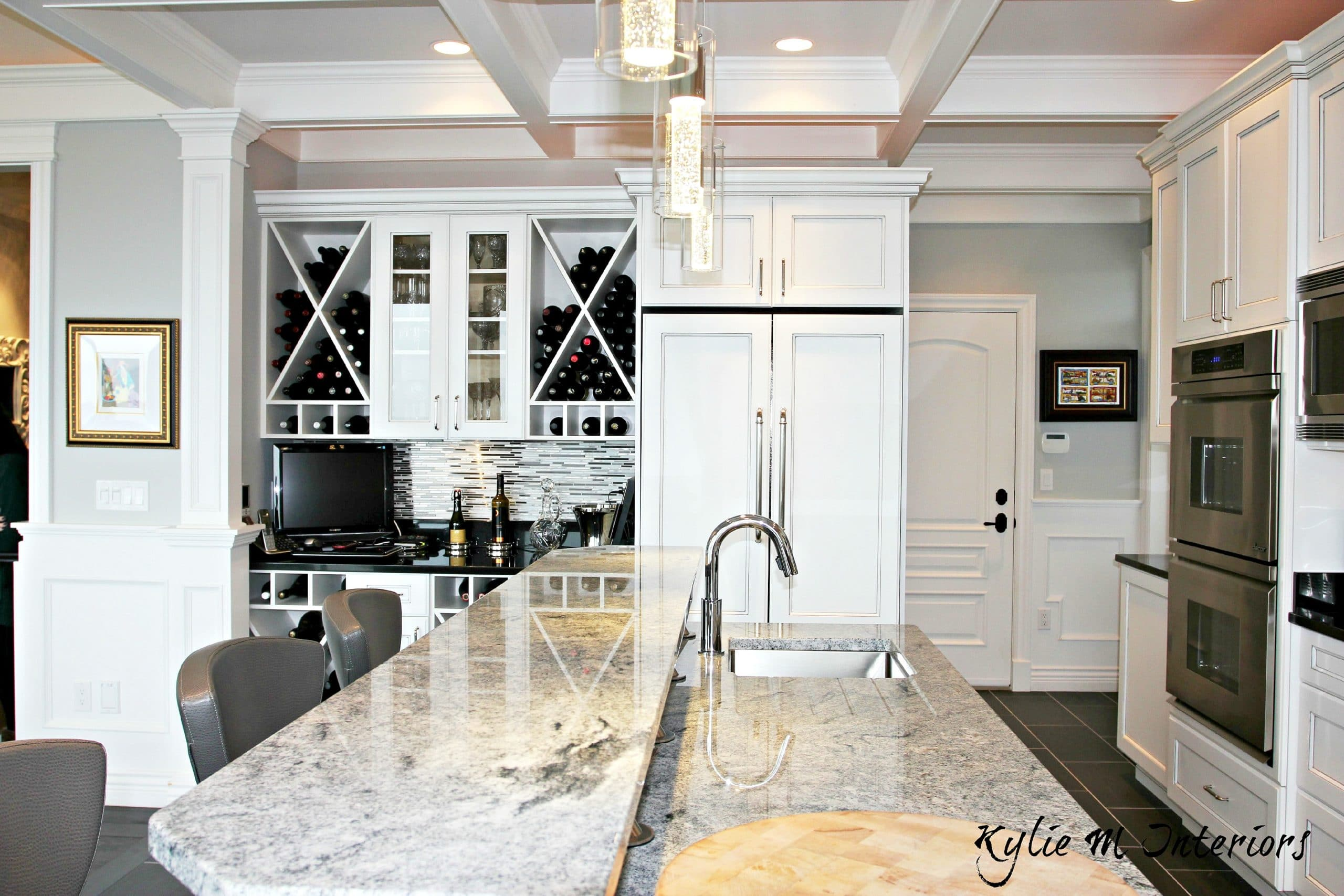 Marble Island With Raised Bar Top, Wine Bar Station With White Glazed  Cabinets, Coffered Ceilings And Benjamin Moore Stonington Gray Walls.