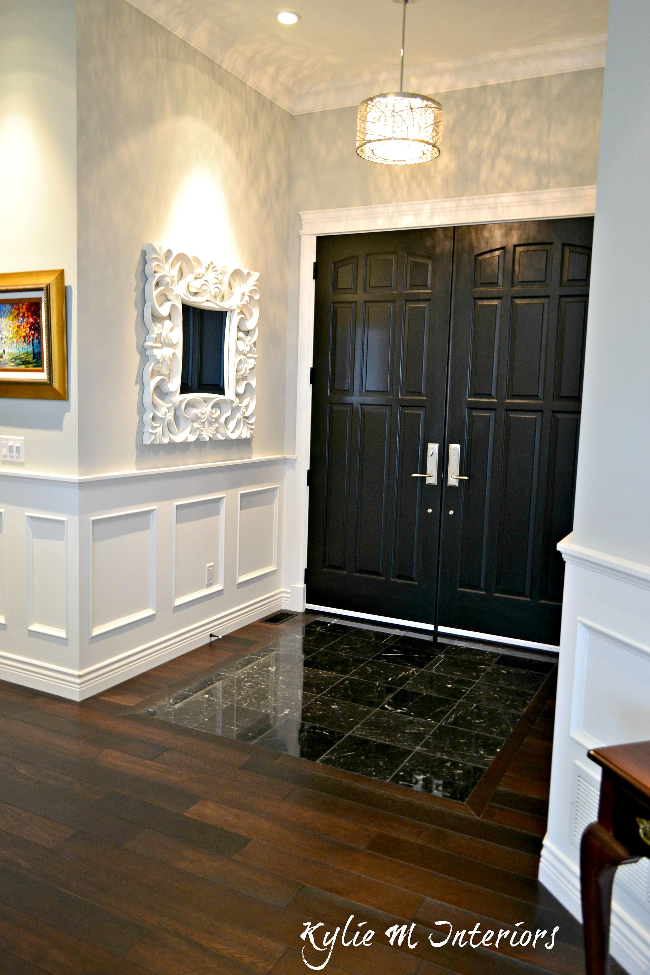 Entryway with dark wood flooring black marble tile and for Front door enters into kitchen