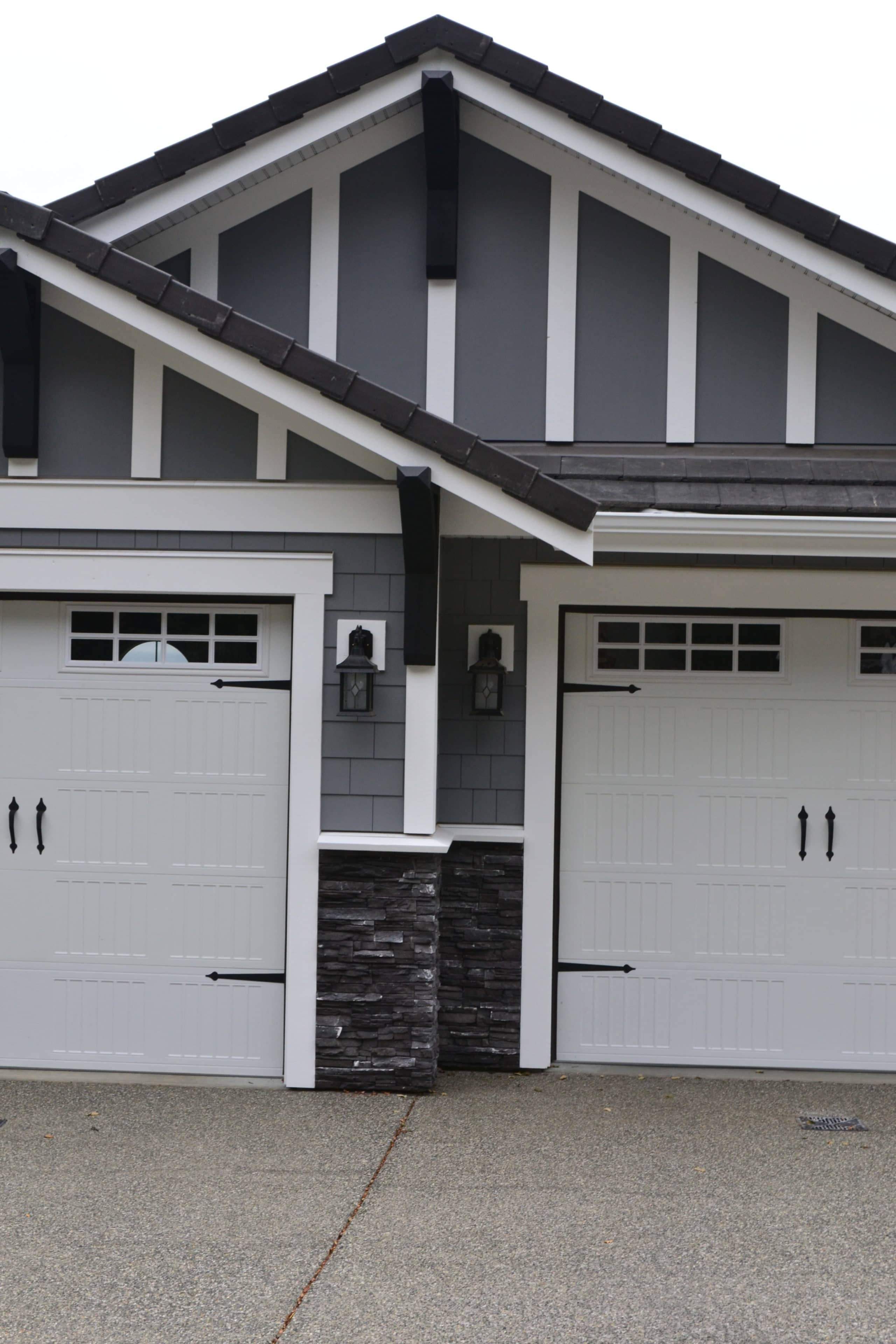 Exterior With Chelsea Gray Colour Hardiboard With White Trim Garage