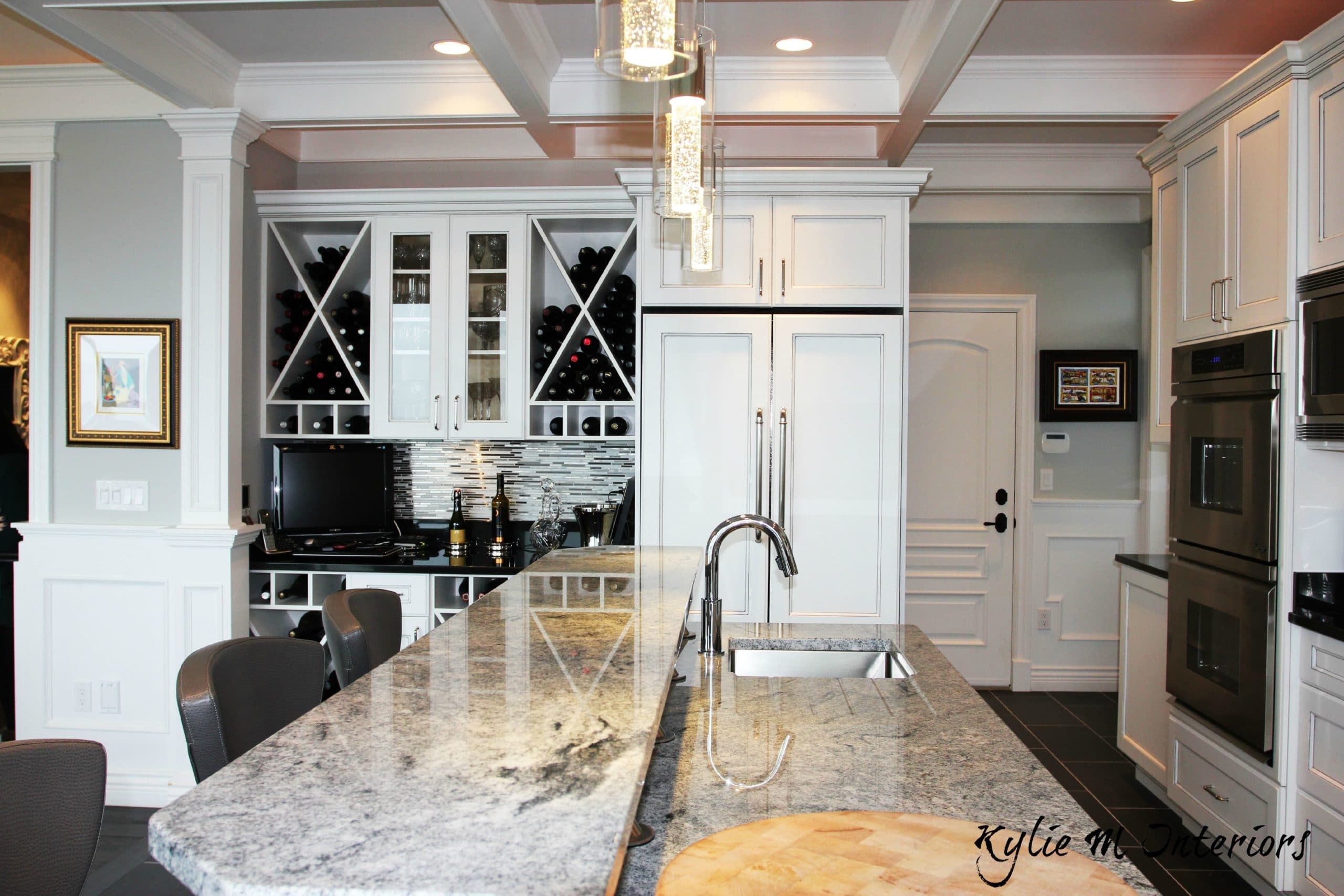 Island With Raised Bar Top. Wine Station And Fridge With