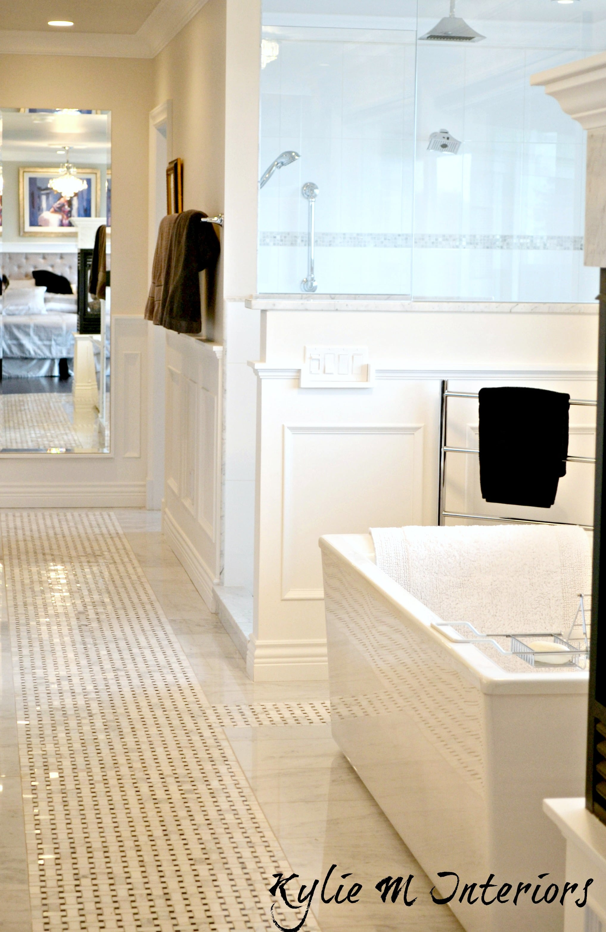 Master Bathroom With Basketweave Marble Tile Floor, Cloud White Walls And  Wainscoting With Freestanding Tub And Walk In Shower