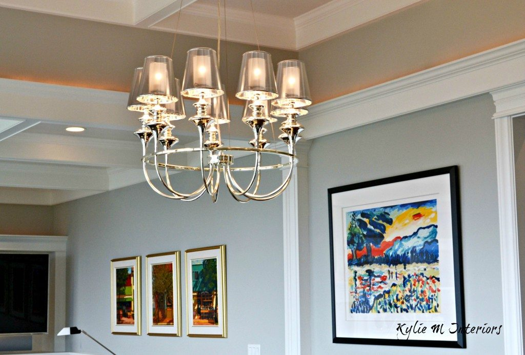 dining room chandelier in modern contemporary style new home with Benjamin Moore Stonington Gray and gallery style artwork display