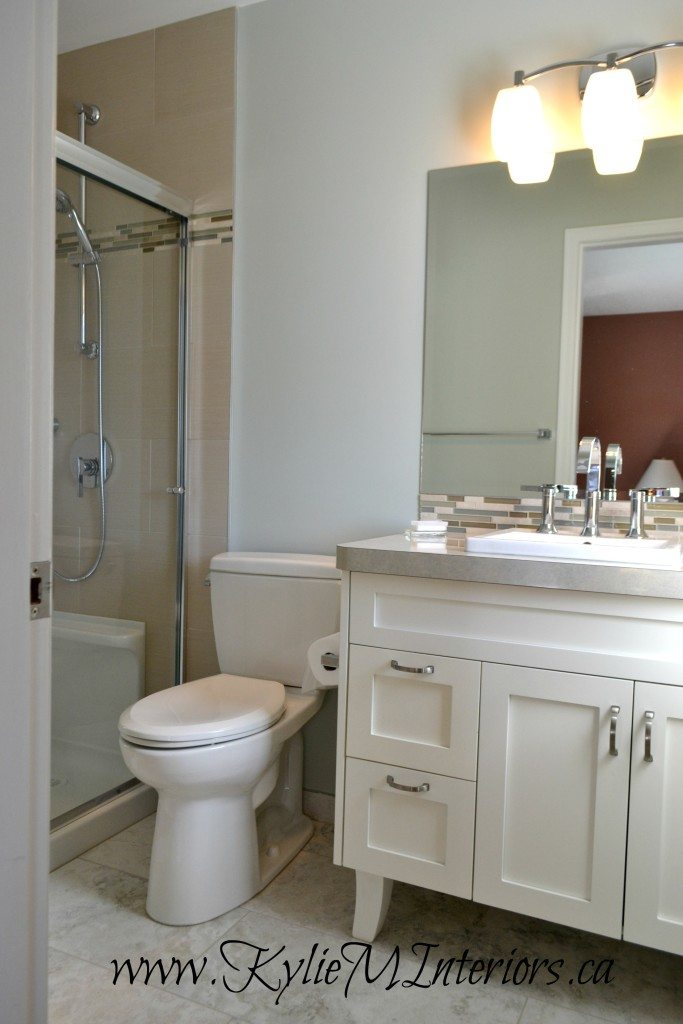 Ideas to update an outdated bathroom wtih walk in shower, white vanity and Benjamin Moore Gray Cashmere walls