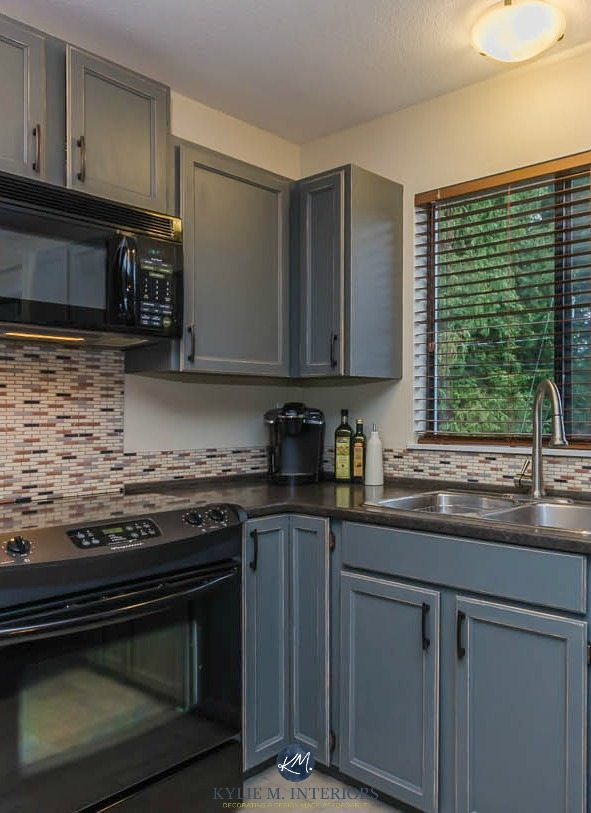Oak cabinets painted Benjamin Moore Chelsea Gray with MIneral Jet formica countertops