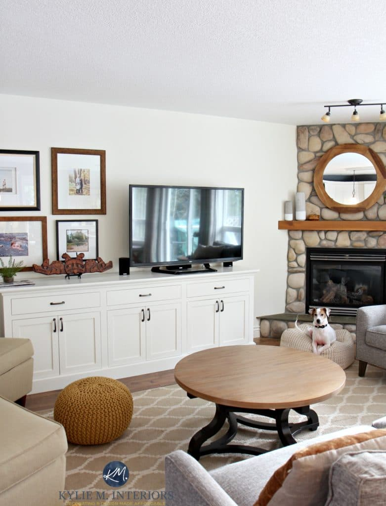 Sherwin Williams Creamy in a living room with stone fireplace, tv and large tv stand and art gallery