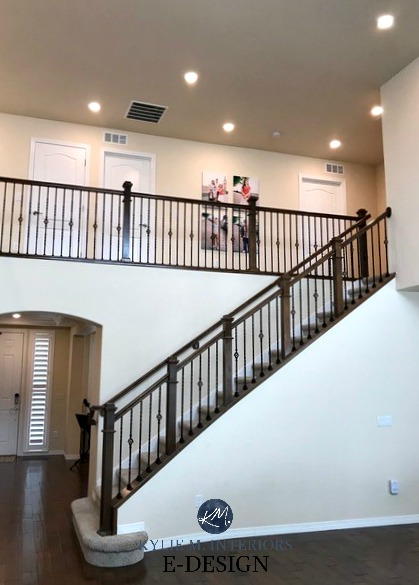 Benjamin Moore Navajo White 2 sotrey staircase and hallway. Best cream paint colour, dark wood floor and railing. North facing, northern Kylie M E-design client photo