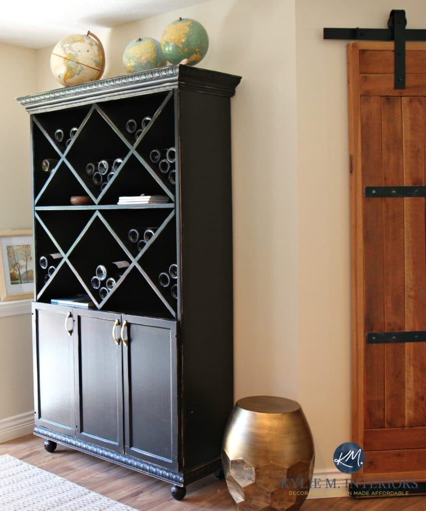 Black and distressed homemade wood wine cabinet in family room