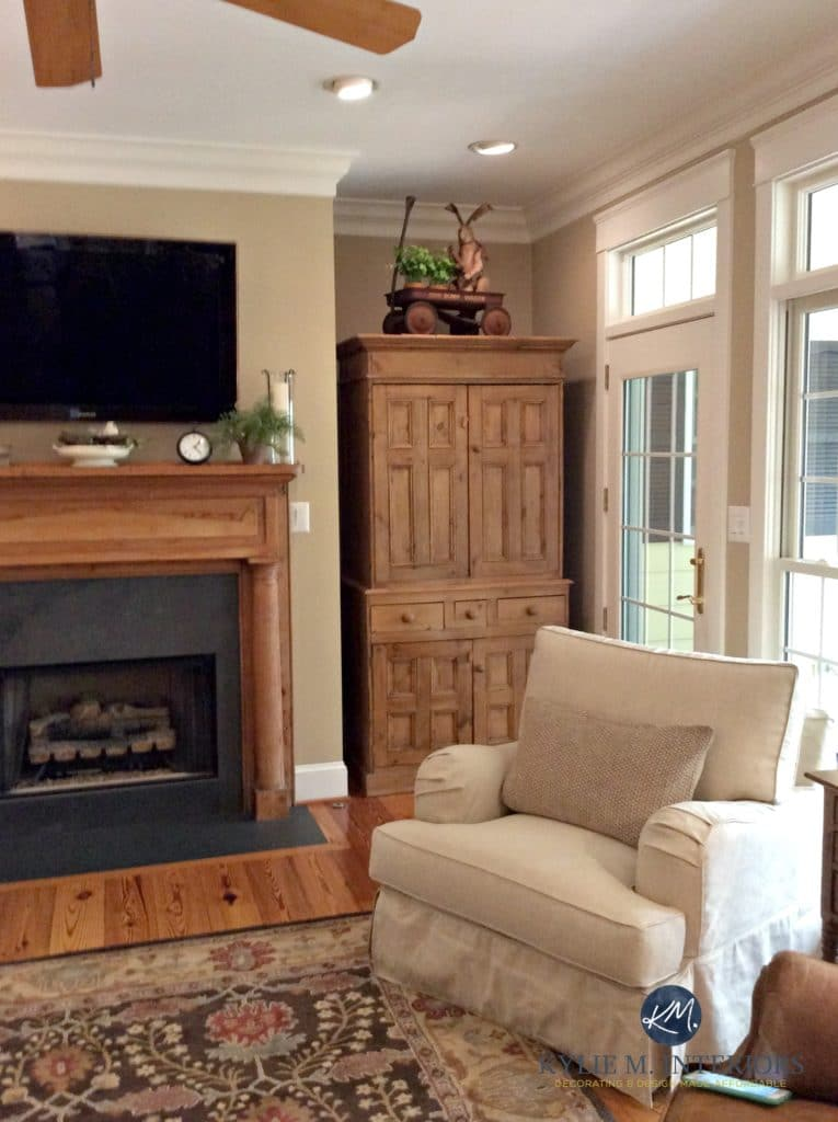 Lenox Tan Benjamin Moore in warm, farmhouse style living room with oak, pine and wood fireplace. Kylie M Interiors E-design and ONline Colour Consulting services