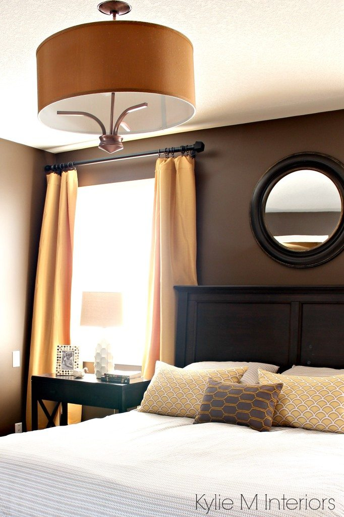 Bedroom painted Benjamin Moore Brown Horse, with gold, yellow and beige accents, dark wood headboard, side tables and home decor. Kylie M Interiors Decorating and Design Blog
