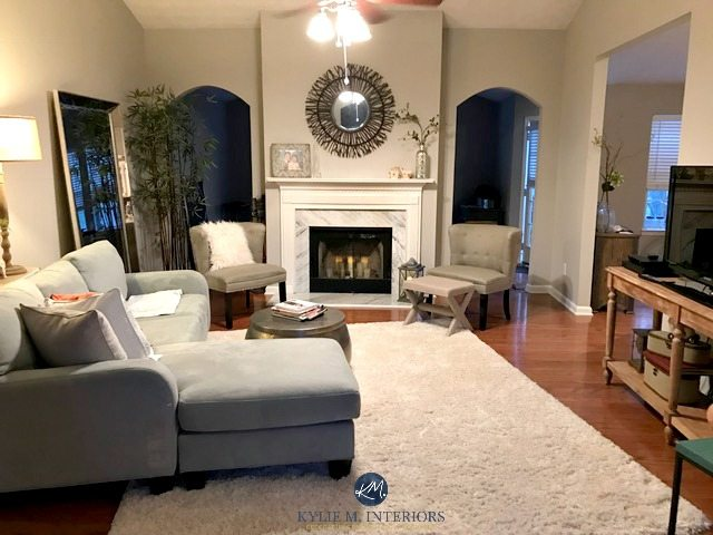 Collonade Gray in a living room with marble fireplace and arched doorways. Kylie M Interiors E-design