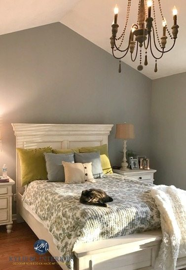 Sherwin Williams Ellie Gray in a master bedroom with white furniture and cathedral ceiling. Kylie M Interiors e-design