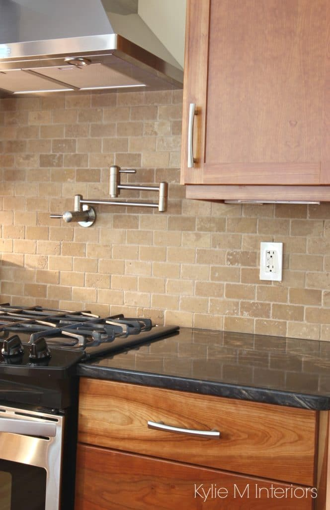 Natural cherry cabinets, black granite, travertine tile subway backsplash, pot filler, stainless steel