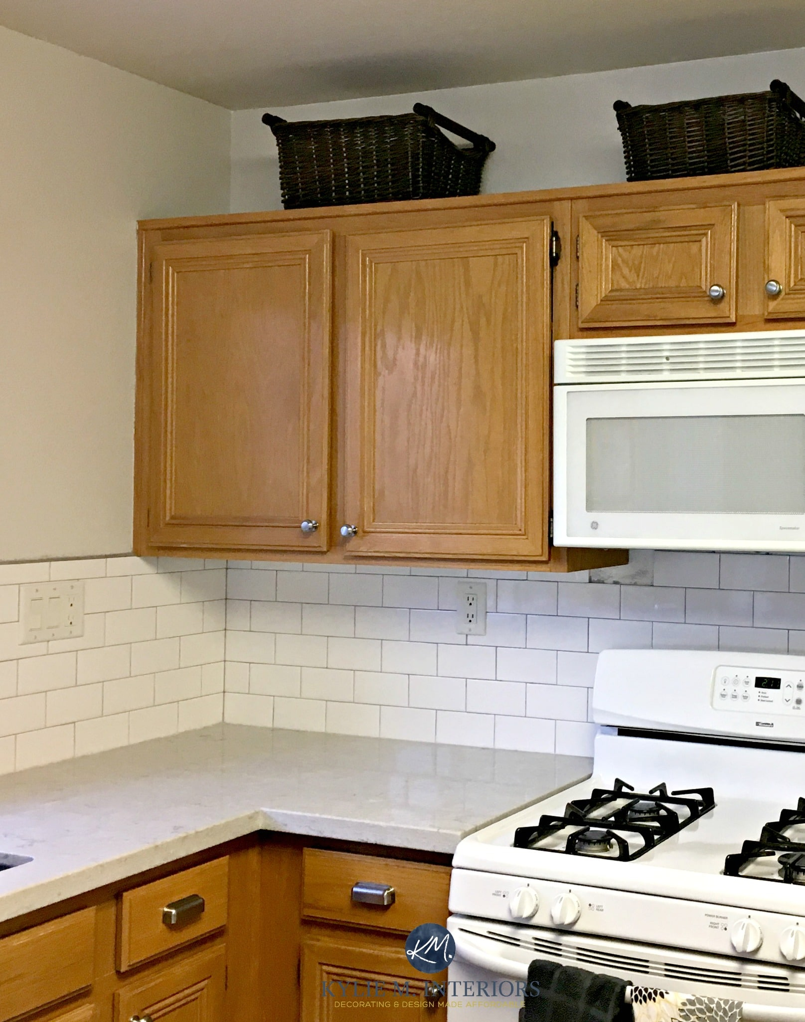 Benjamin Moore Classic Gray In A Kitchen With Oak Wood Cabinets White Subway Tile And Bianco