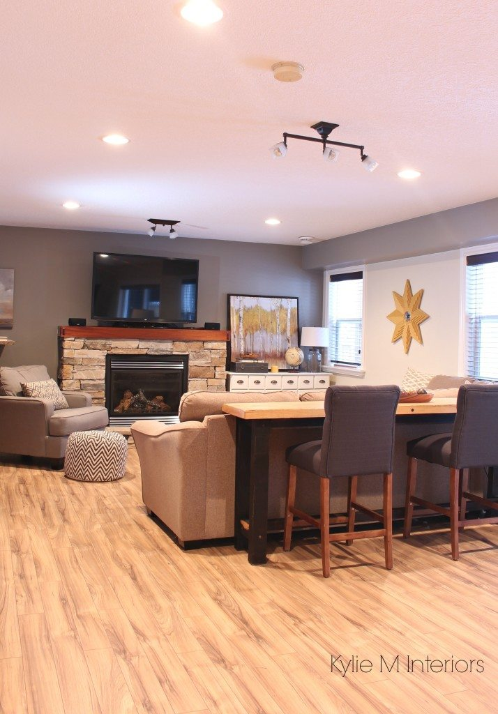 Family room decorating and decor ideas with sectional couch, sofa table, tv above stone fireplace and Sherwin Williams Pewter Tankard