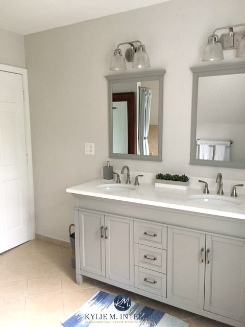 Benjamin Moore Balboa Mist in bathroom with beige tile and gray and white vanity. Kylie M INteriors E-design and online colour consulting services