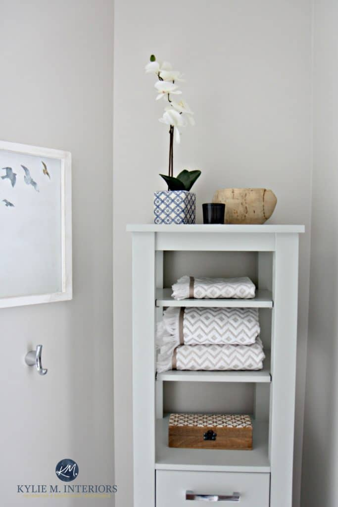 Benjamin Moore Classic Gray is great for home staging and selling with bathroom decor and linen tower. Kylie M Interiors