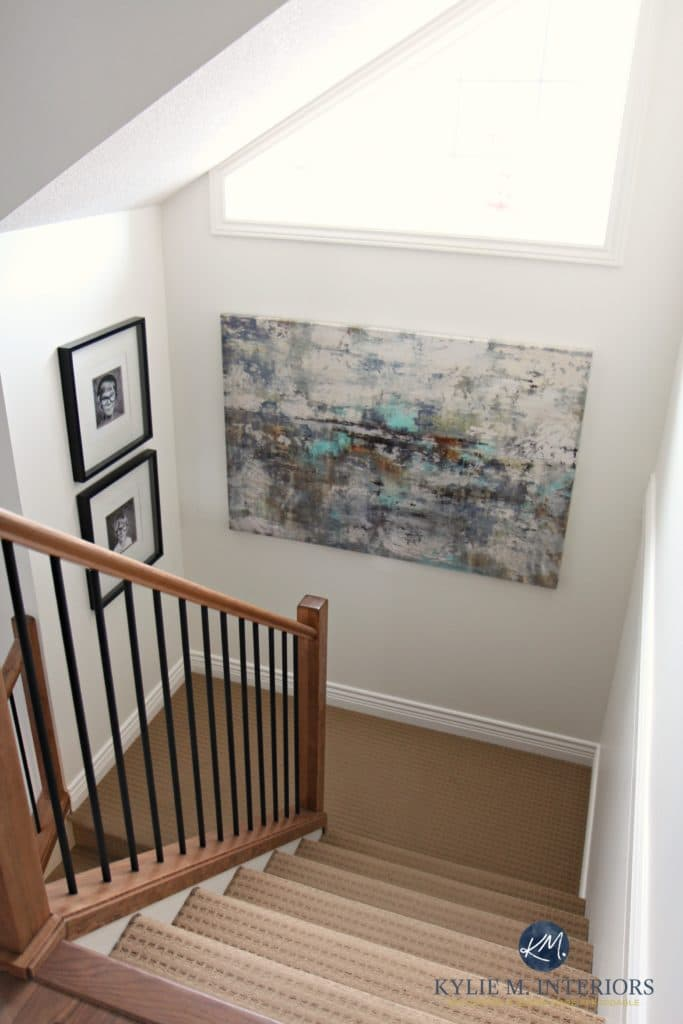 Sherwin Williams Creamy is a great paint color for home staging or selling. As shown in stairway with wood and metal railing by Kylie M Interiors E-design