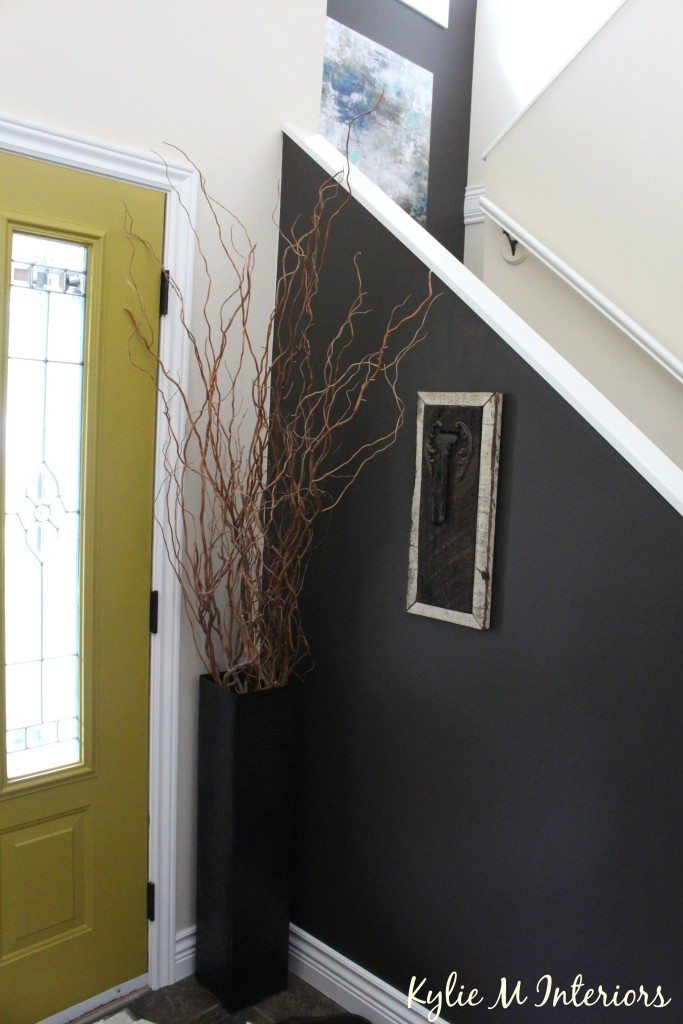 entryway, foyer and stairwell decorating ideas. Behr Gardeners Soil which is the same as Benjamin Moore Willlow. With chartreuse painted front door and Navajo White