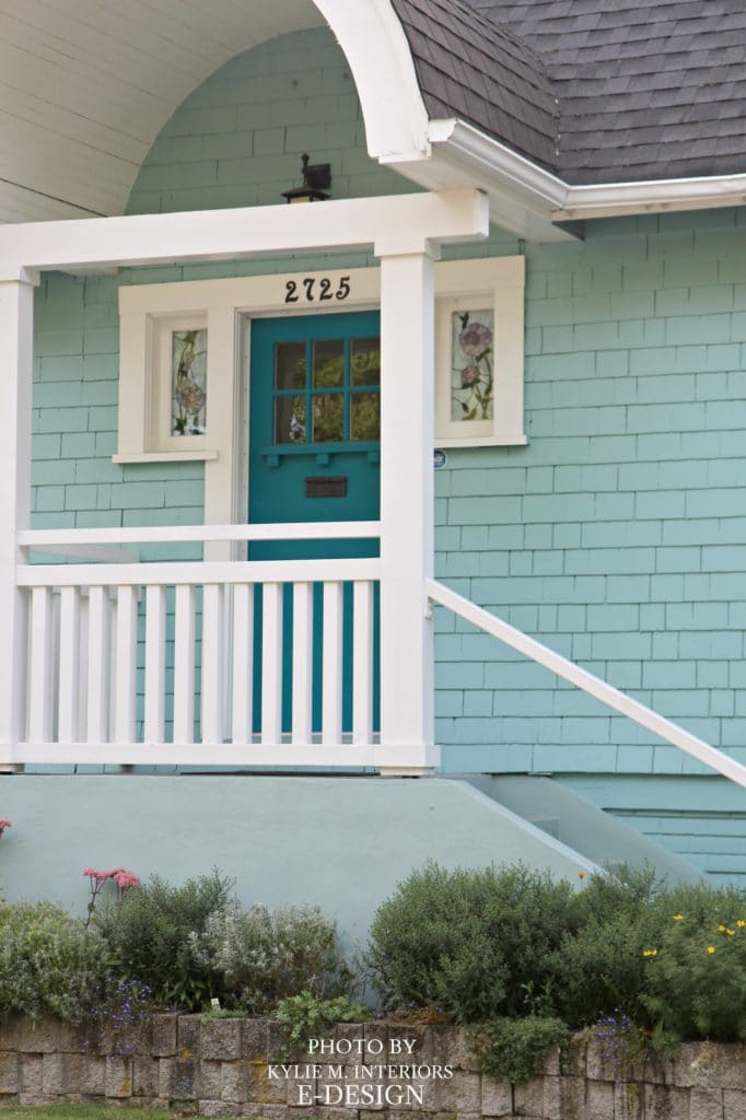 Front door teal colour similar to Sherwin Williams Gulfstream, siding close to Benjamin Moore Covington Blue, white trim. Photo via Kylie M E-design
