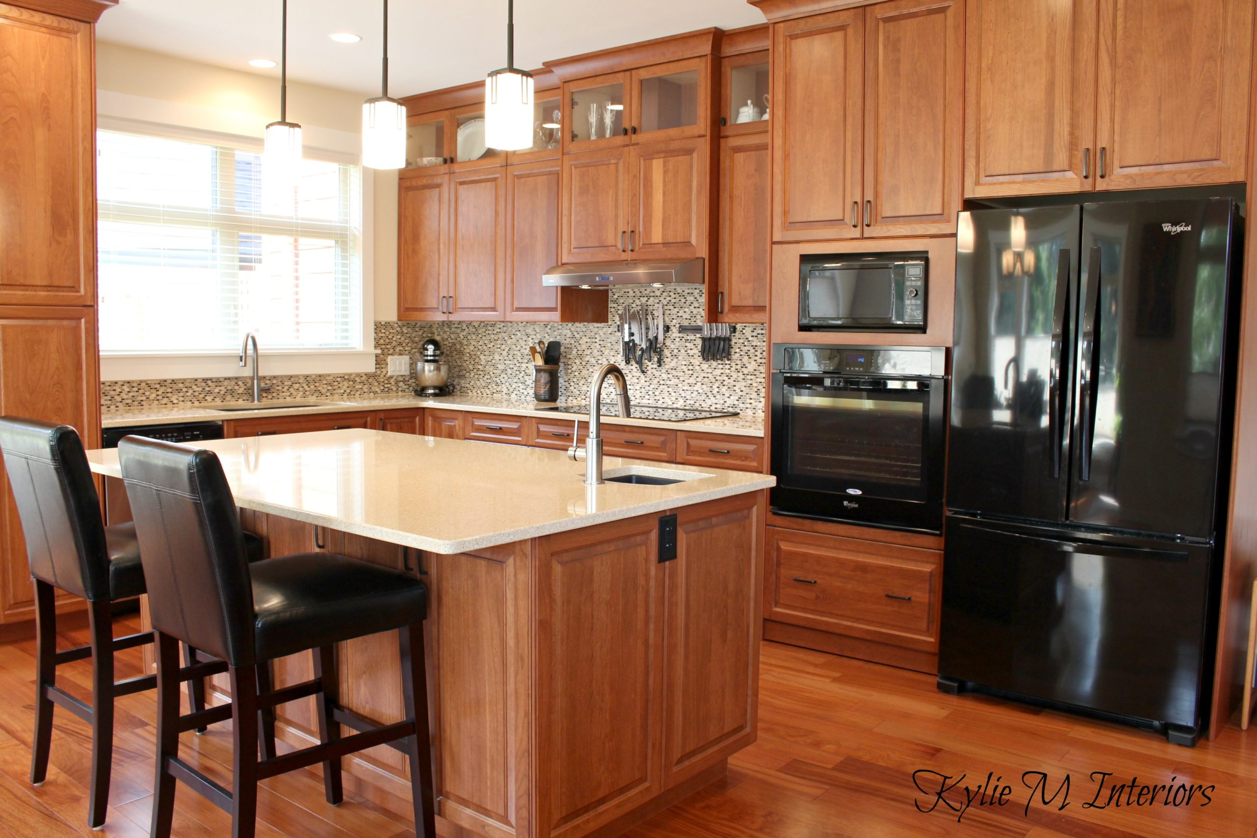 Cherry kitchen cabinets in modern transitional kitchen for Kitchen cabinets with black appliances