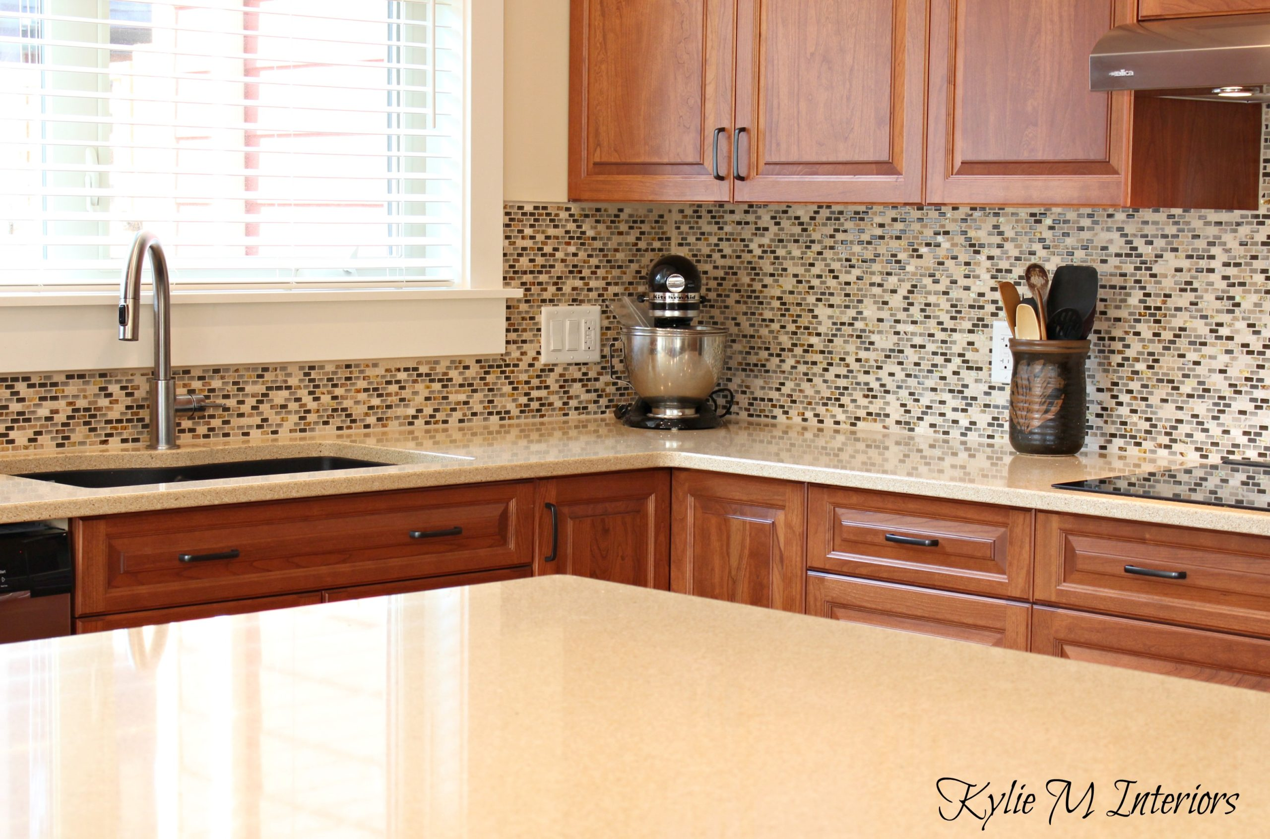 cream quartz countertops cherry kitchen cabinets small mosaic