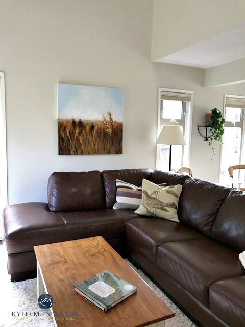 Benjamin Moore Ballet White in livign room with vaulted ceilings and brown leather couch. Kylie M interiors Online Colour Consulting and E-decor services