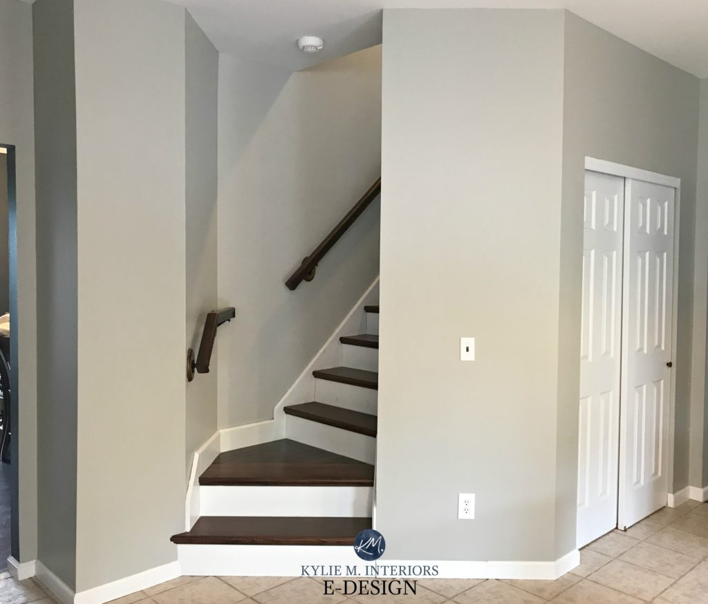Sherwin Williams Mindful Gray in stairwell, north facing, wood steps white riser. Beige porcelain tile floor. Kylie M Interiors Edesign