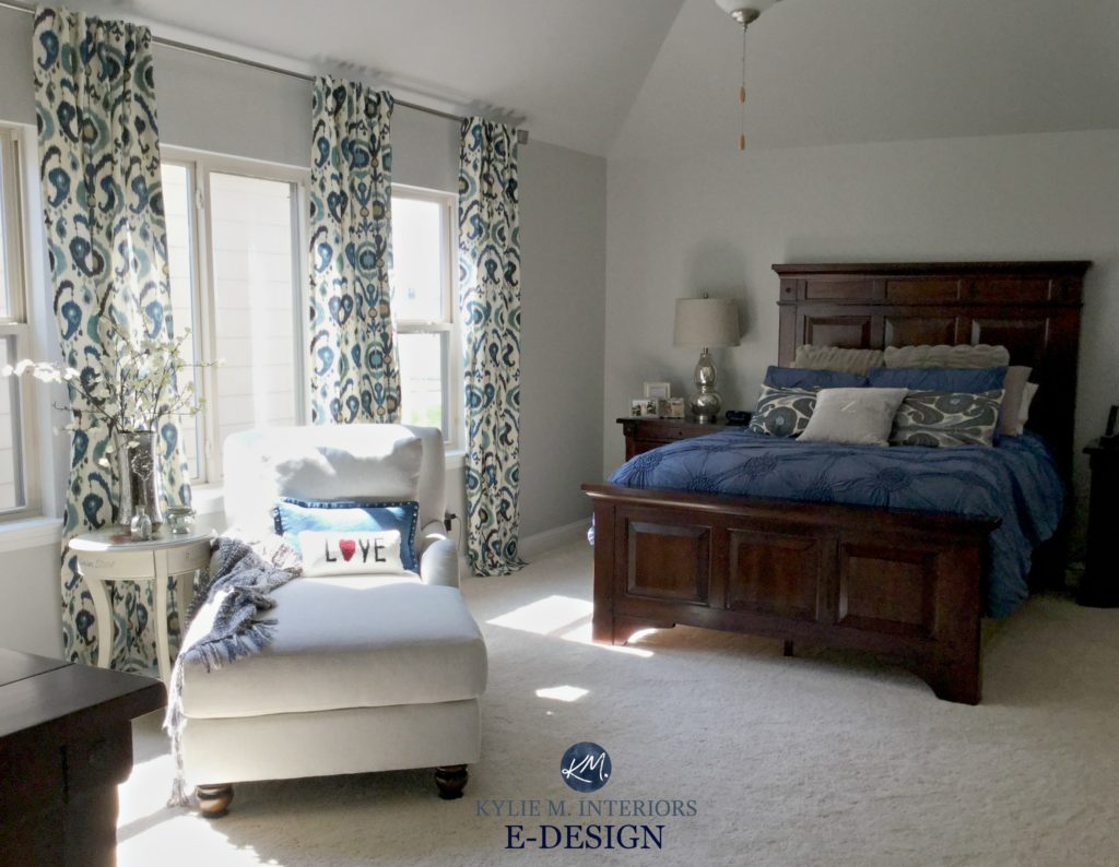 Sherwin Williams Repose Gray, master bedroom with dark cherry wood furniture, navy blue, white and red accents. Kylie M E-design and online color consulting expert