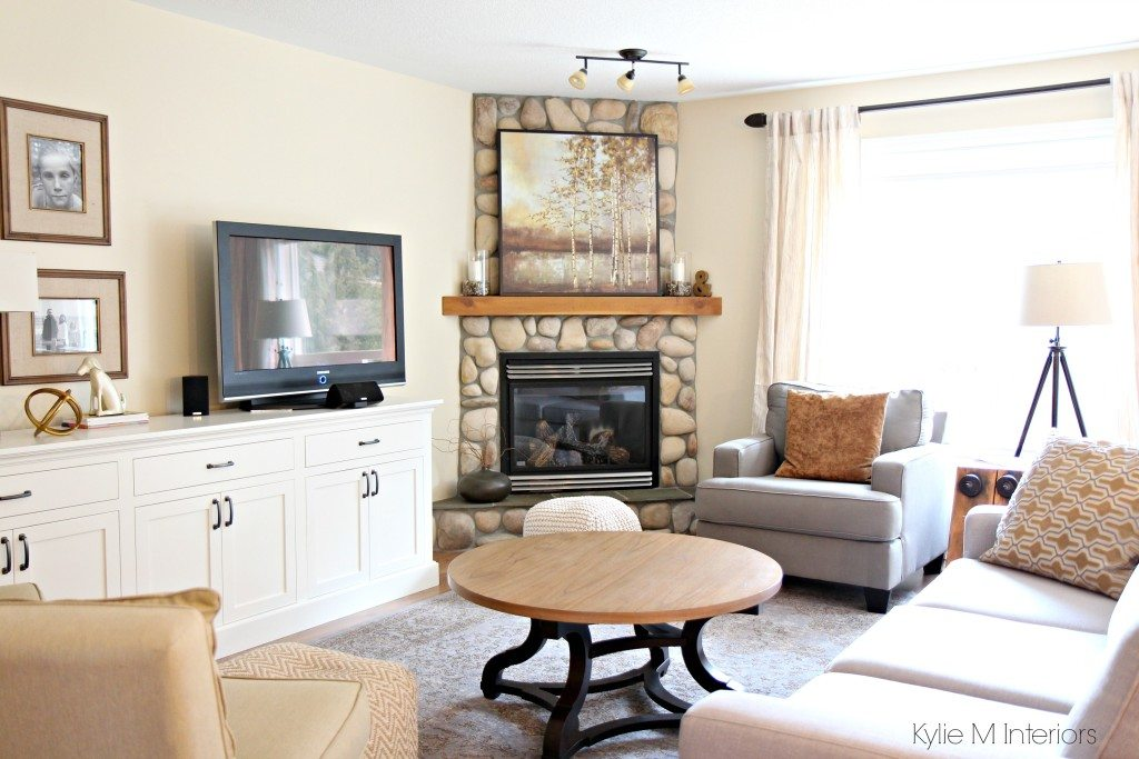 South facing living room with stone corner fireplace, furniture, home decor and custom tv stand
