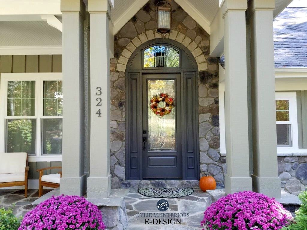 Stone exterior around front door with patio and beams. Kylie M Interiors Edesign, online paint color consultant. DIY Decorating and design. Front door painted Benjamin Moore Gray 2121-10