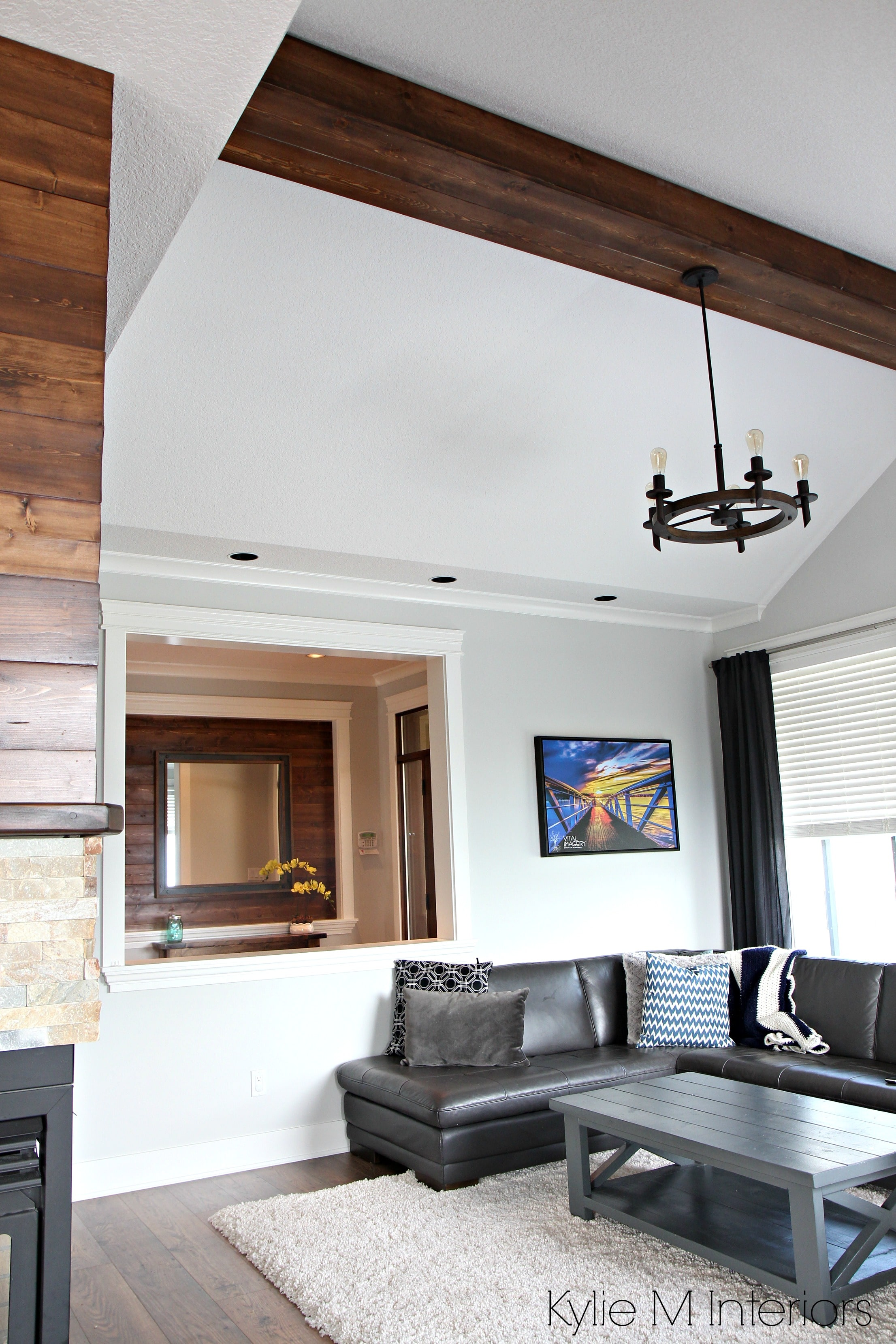 Living room design with vaulted ceiling, faux wood beam ...