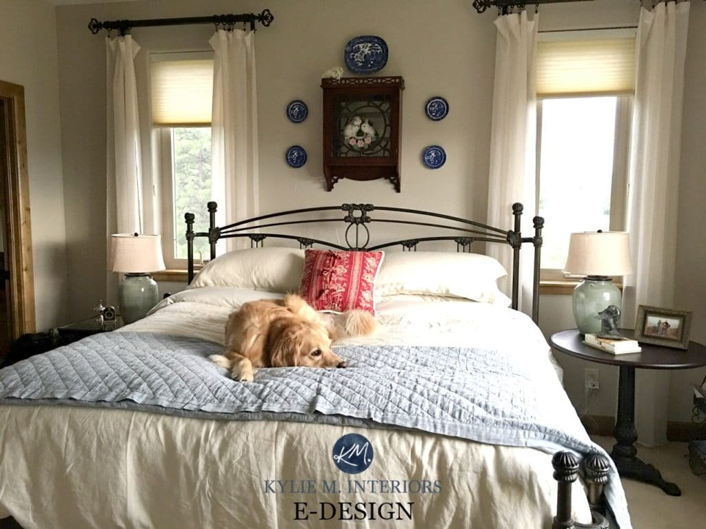 Sherwin Williams Accessible Beige in a country farmhouse style guest bedroom with wood trim and neutral bed linens. Kylie M E-design and ONline Color consulting