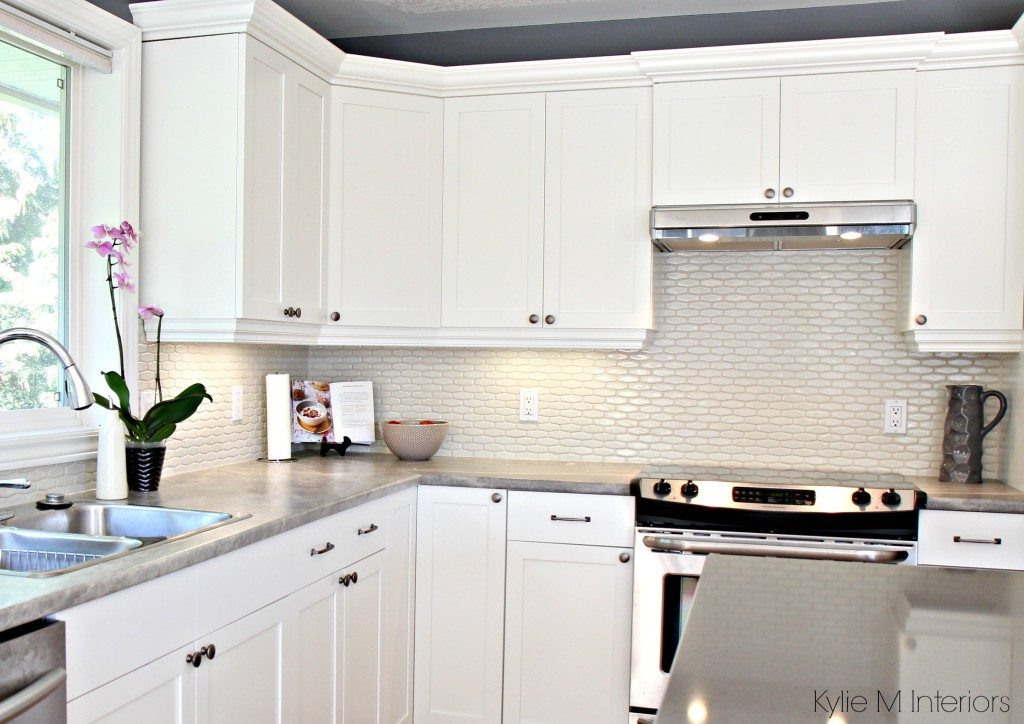 Maple cabinets painted Cloud White, Gray paint colour, quartz, hexagon subway tile cream backsplash and soapstone formica countertops