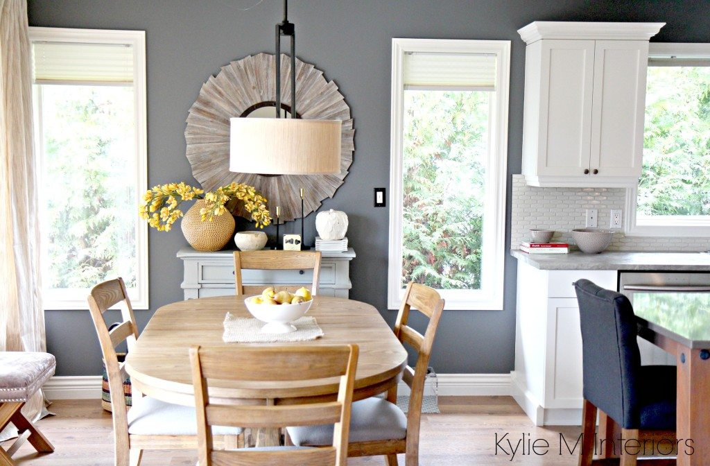 Open layout farmhouse style dining room and kitchen with Benjamin Moore Steel Wool, Cloud White and round oak table with home decor in country style