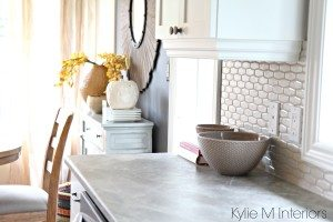 Soapstone Sequoia formica countertops with cloud white cabinets and countertop decor