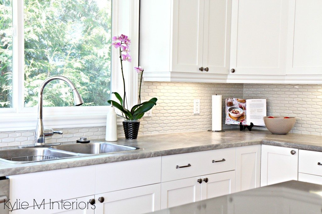 hexagon subway tile backsplash. Maple cabinets painted Cloud White, soapstone formica countertops and gray quartz with kitchen decor