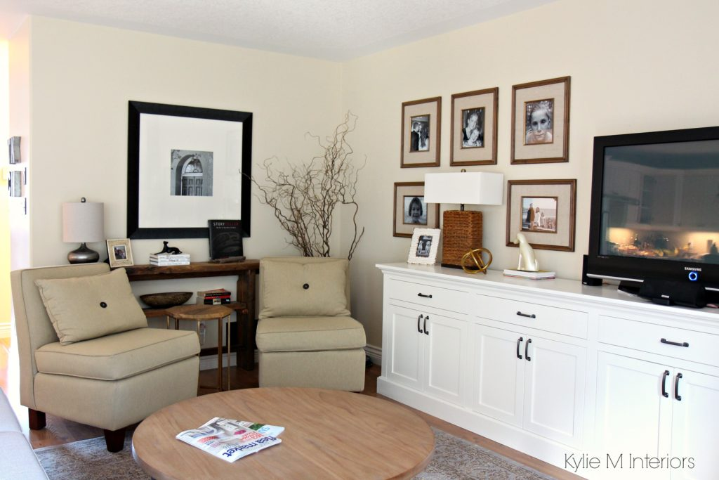 Living room layout with 2 chairs, family photo gallery above TV cabinet and home decor that has reclaimed wood