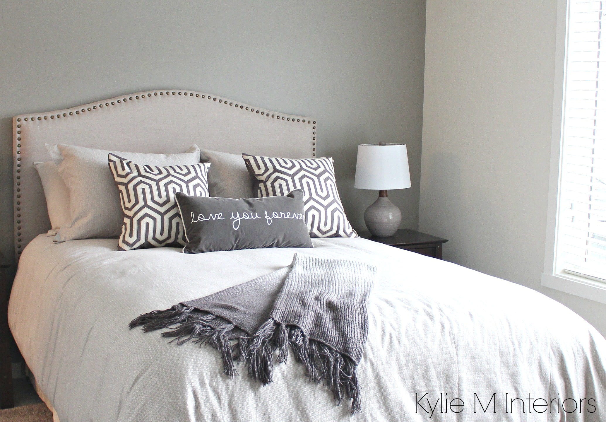 Bedroom with south west exposure painted in gray to accommodate for natural light. Sherwin Williams Dorian Gray feature wall by Kylie M Interiors