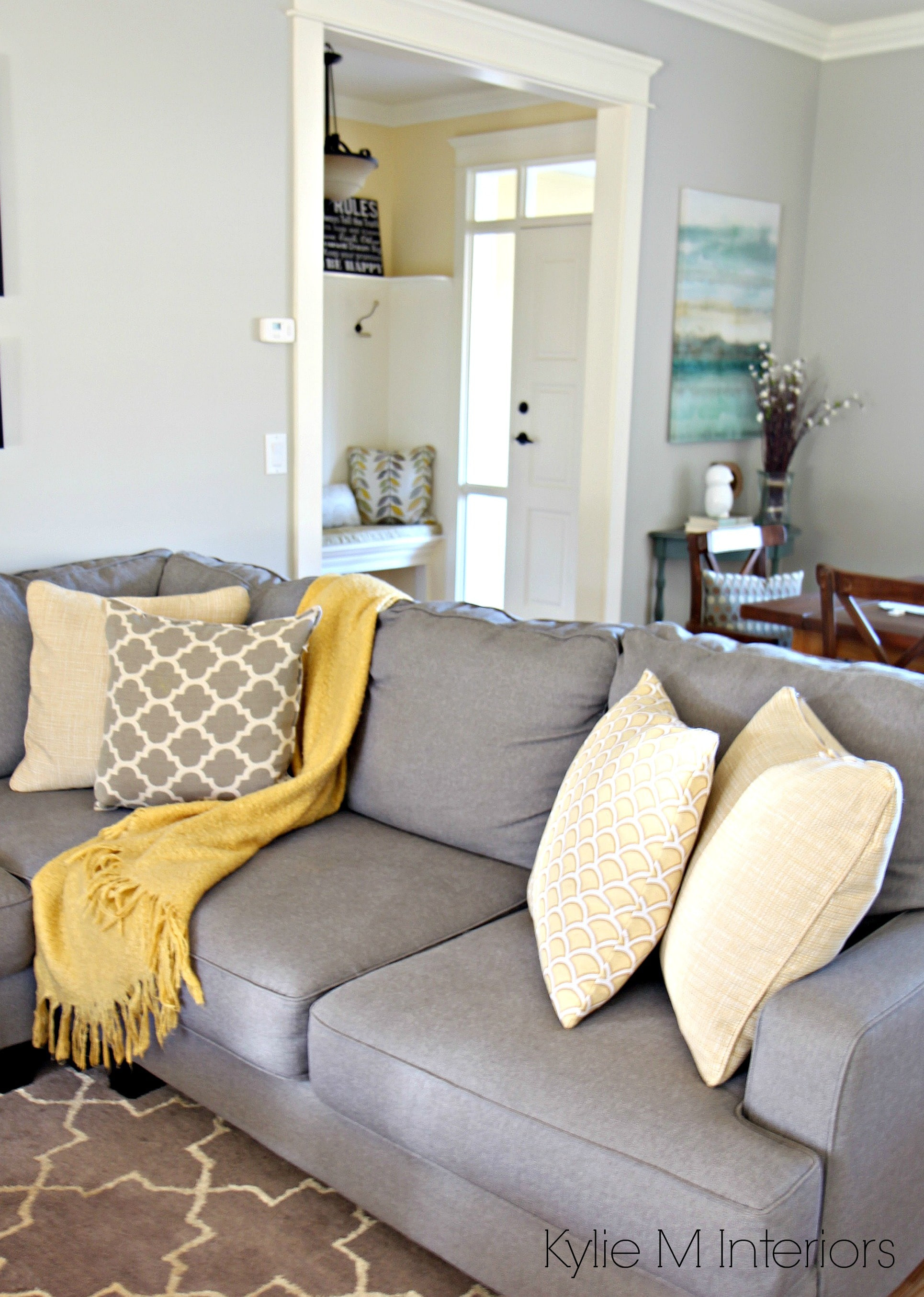 How to make a gray paint colour feel warm shown in living room with revere pewter gray Gray blue yellow living room