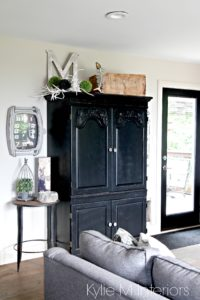Black painted cabinet with farmhouse and country style decor. Benjamin Moore Grant Beige