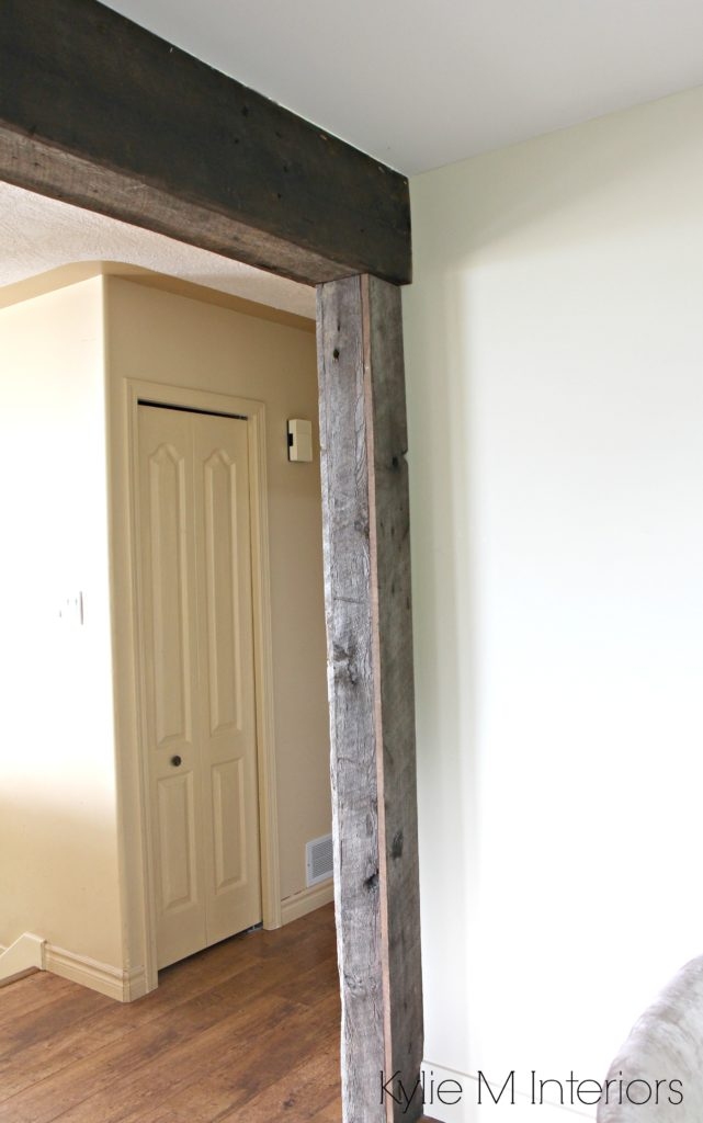 Rustic reclaimed wood beams and supports over widened doorway or opening. Paint colour Grant Beige. Design Kylie M Interiors