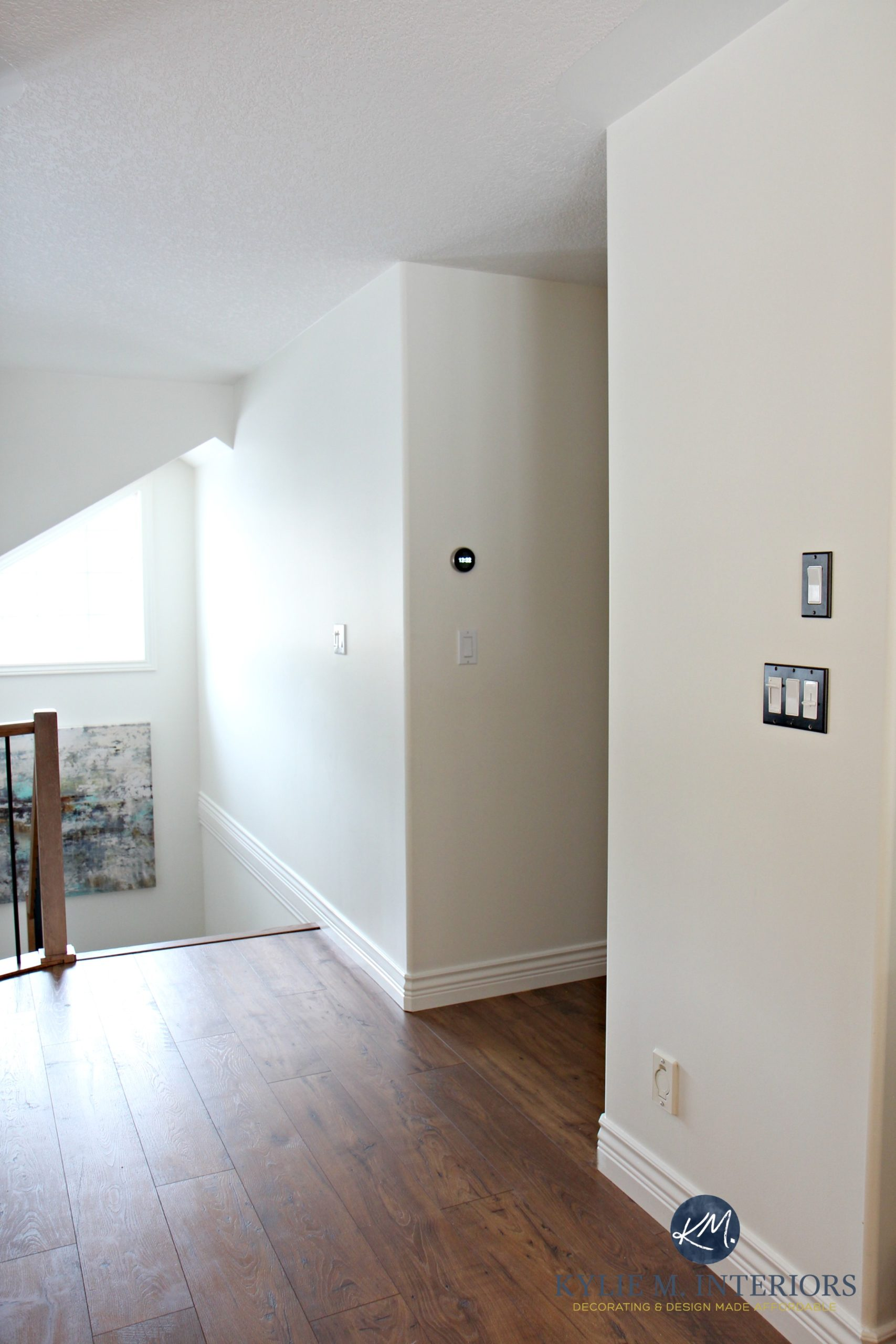 Sherwin Williams Creamy In A North Facing Stairwell And A Dark Hallway With  Laminate Wood Flooring. Kylie M Interiors