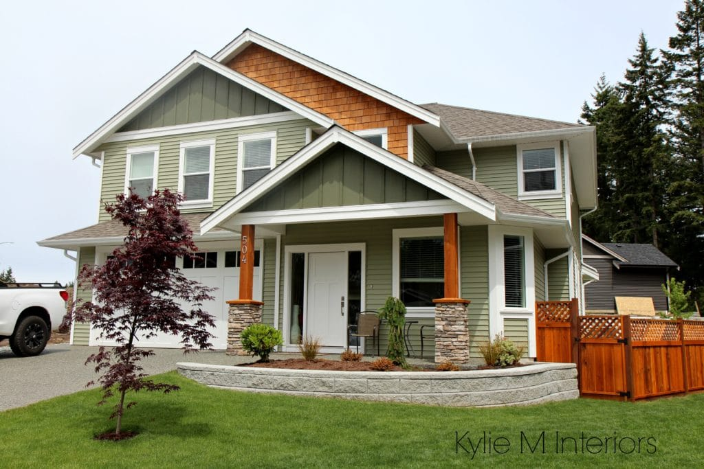 Exterior colour palette with green vinyl siding, cedar shingles and Cloud White trim by Kylie M INteriors E-decorating services