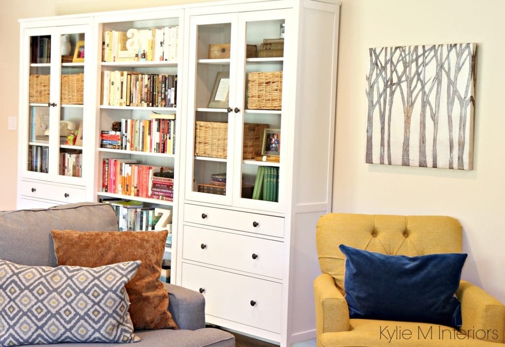 Family room with Ikea Hemnes bookcase and bookshelf. Long wall with Benjamin Moore Gentle Cream by Kylie M Interiors e-decor and design online