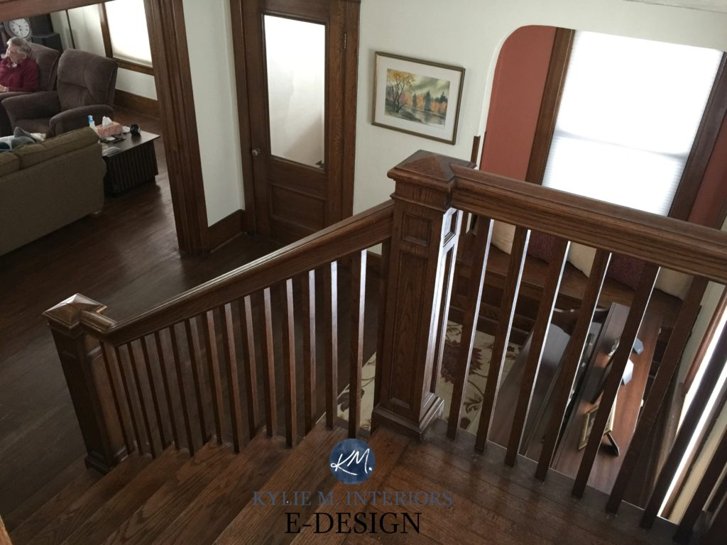 Dark wood trim, stairs and doors in older home entryway, best paint colour soft white, similar to SW White Duck or Alabaster. Kylie M INteriors E-design, before image. Client design