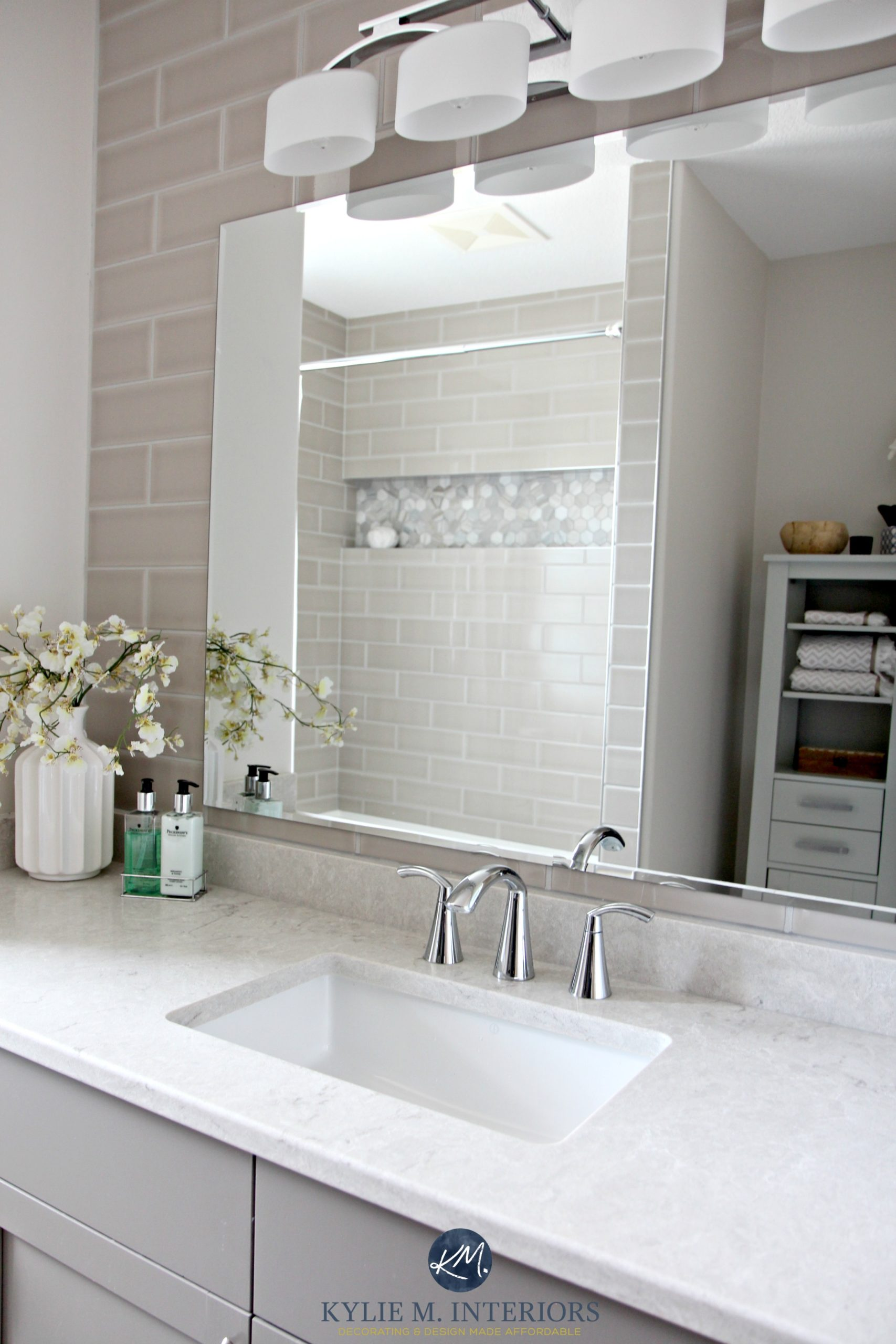 Bathroom with subway tile wall behind vanity. Bianco Drift quartz by ...