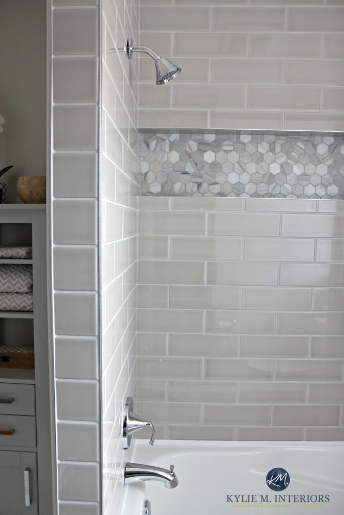 Bathroom with tub remodel with Moen Glyde fixtures, greige and gray subway tile and hexagon marble niche or alcove by Kylie M INteriors